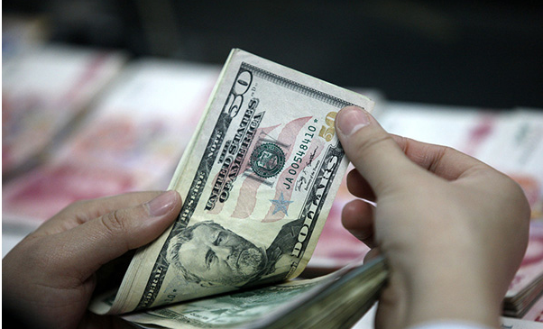 China's forex reserves post biggest monthly drop on record